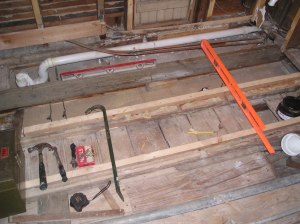 "I had to ""sister"" some of the floor joists to provide a level substratum upon which to lay the 3/4"" ply"