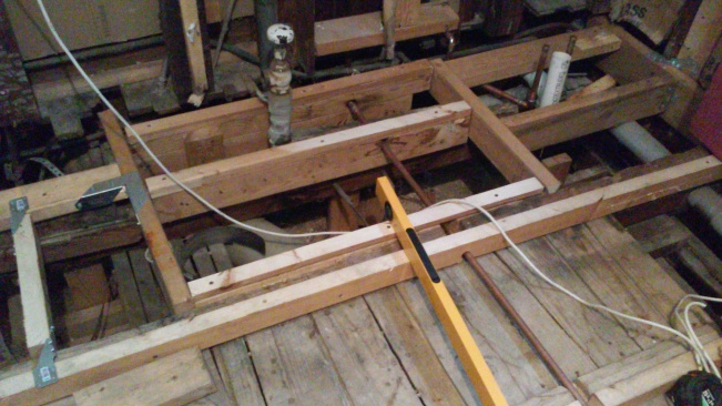 New structural support to help those old floor joists.