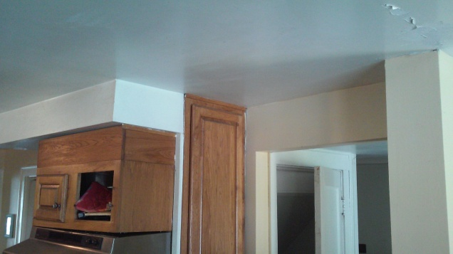note the missing door on the oak cabinet. You will see that there is a brick chimney behind this.